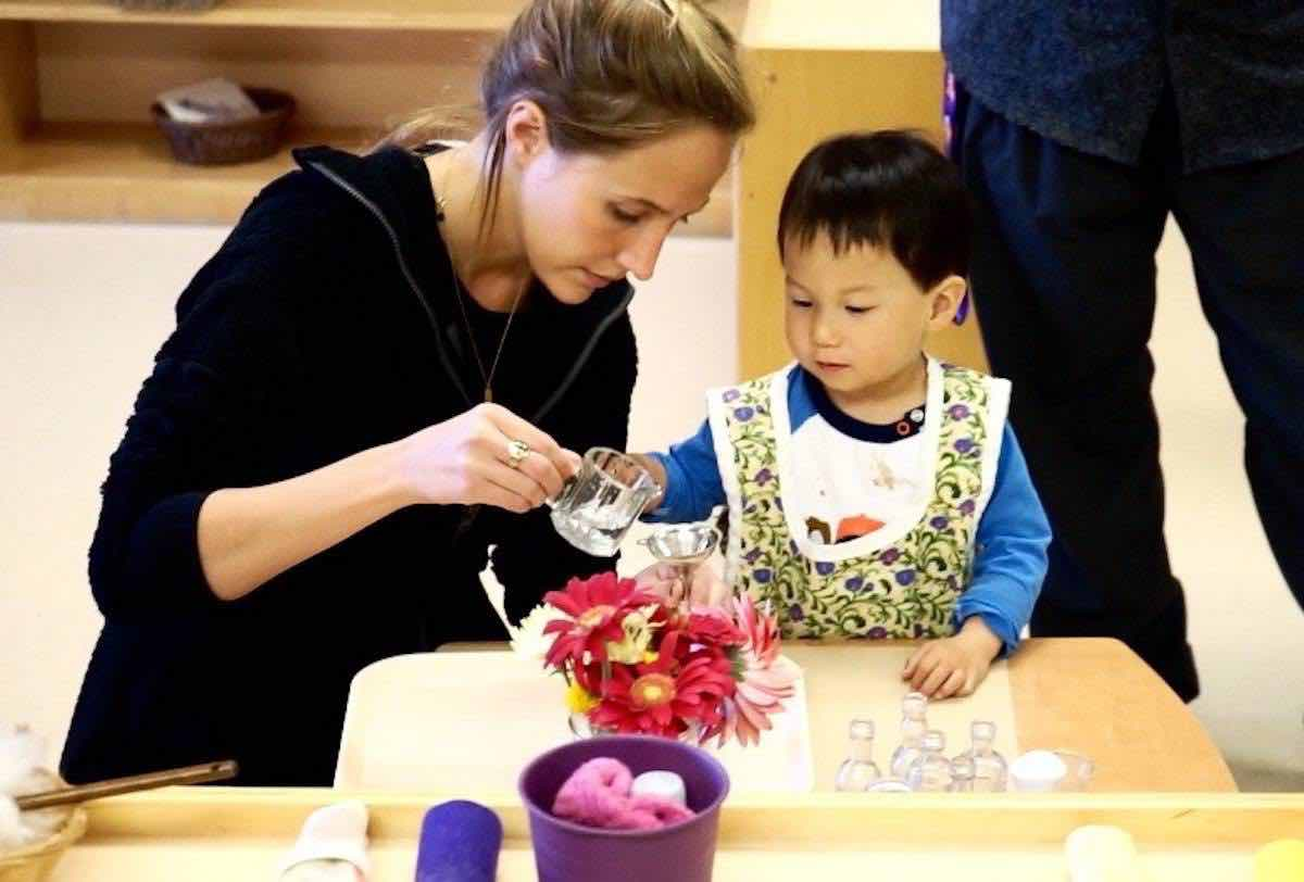 Berenice Saint-Saens in the Montessori classroom with toddler