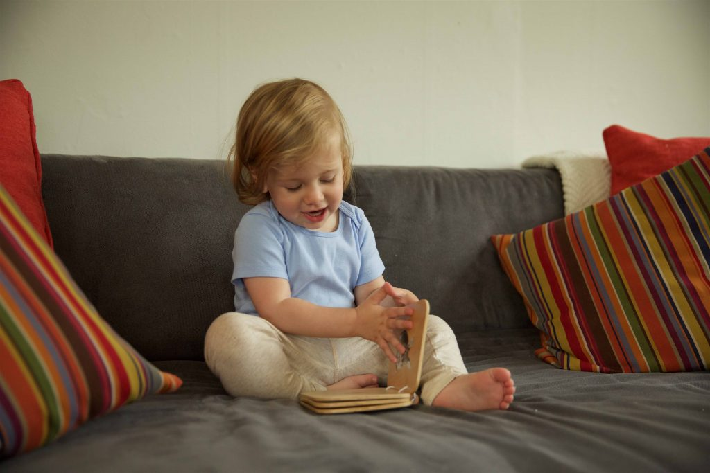 Toddler Reading the Monti Kids Level 2 Wooden Book