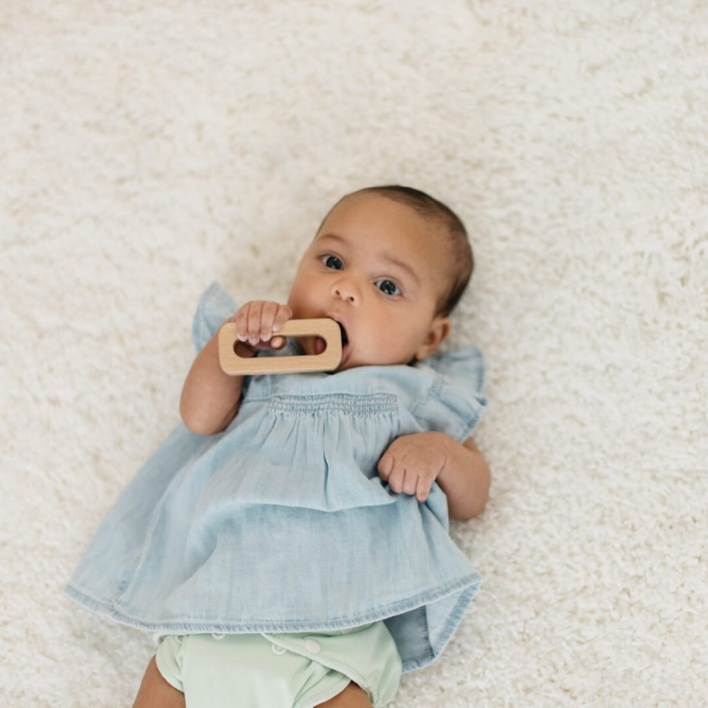 newborn-playing-with-toy