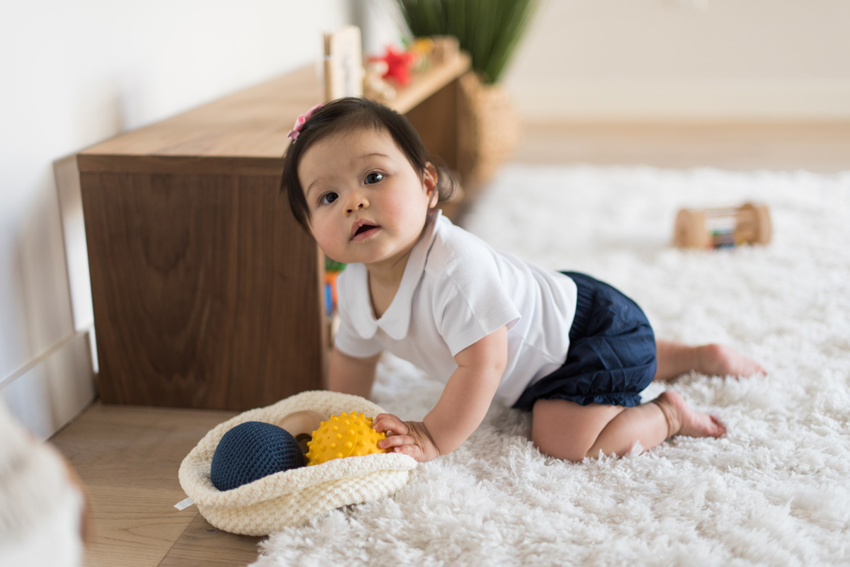 Baby with developmental toys