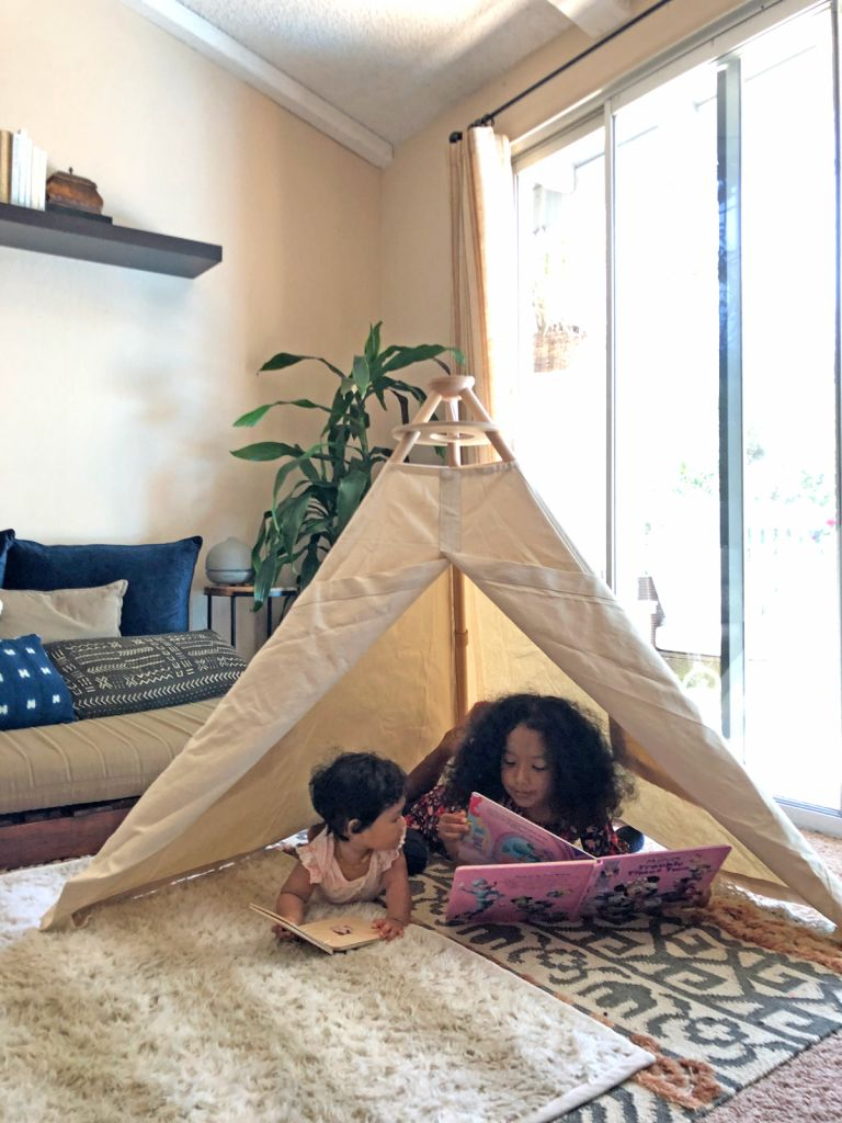 Children reading in play tent