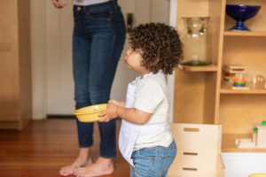 Toddler helping at mealtime