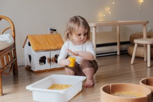 Toddler with Sensory Bin