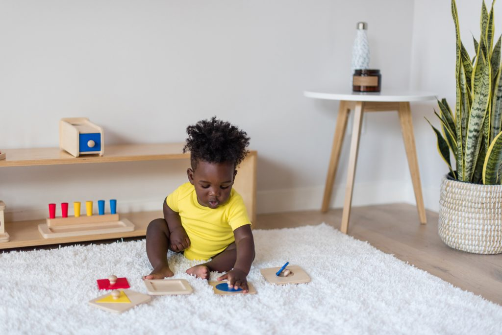 Toddler playing with First Puzzles