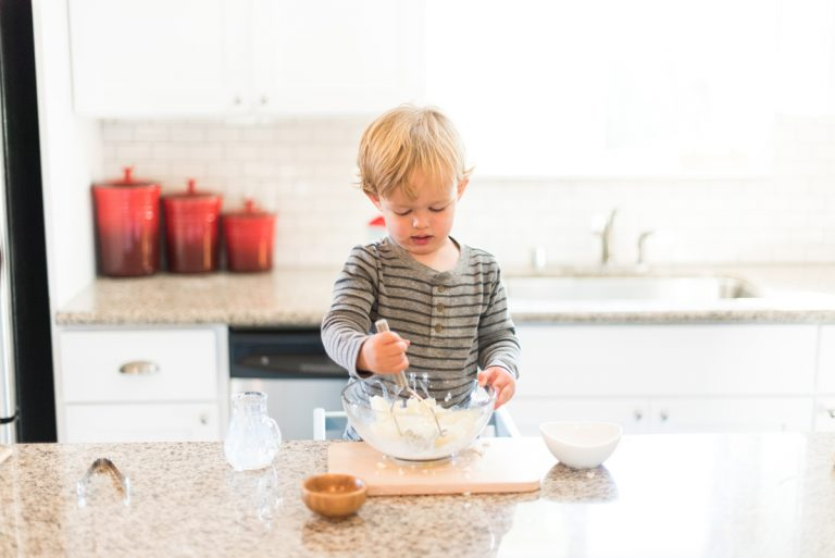 Toddler making mashed potatoes
